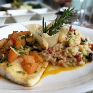 Saiblingfilets mit Tomaten und Mandeln und Gemüserisotto