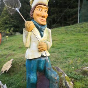 Holzskulptur Koch mit Fischernetz